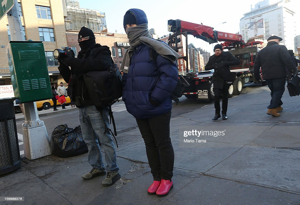 People bundled up against the cold stand on a sidewalk in Manhattan on January 24, 2013 in New York City. Polar air settled in over the northwest U.S. Wednesday, with temperatures in the teens and twenties.