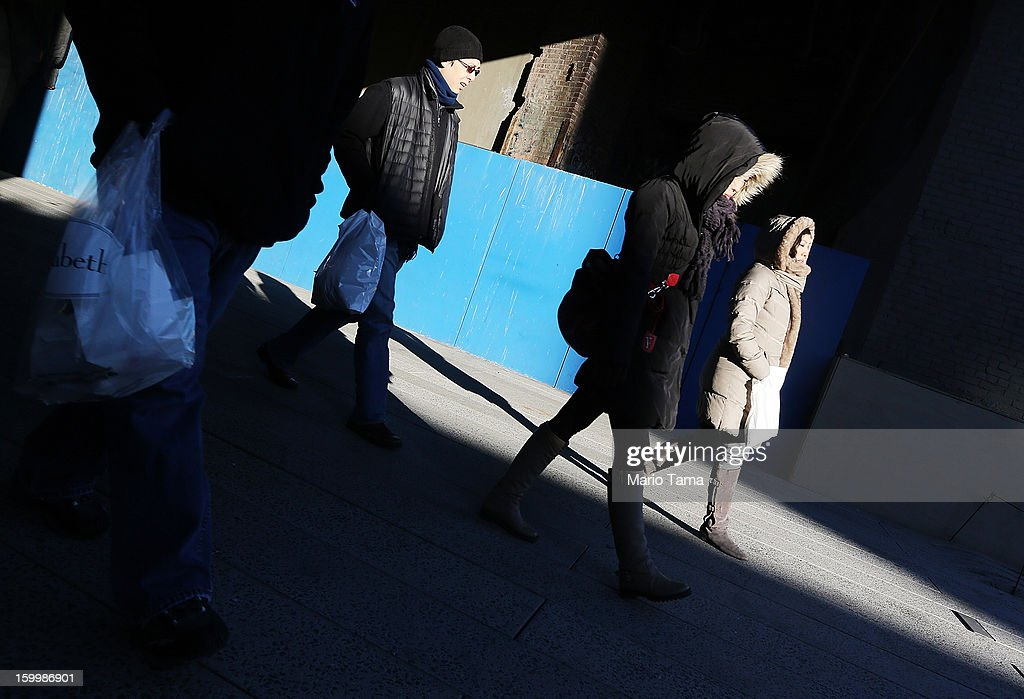 People bundled up against the cold walk through the High Line park in Manhattan on January 24, 2013 in New York City. Polar air settled in over the northwest U.S. Wednesday, with temperatures in the teens and twenties.