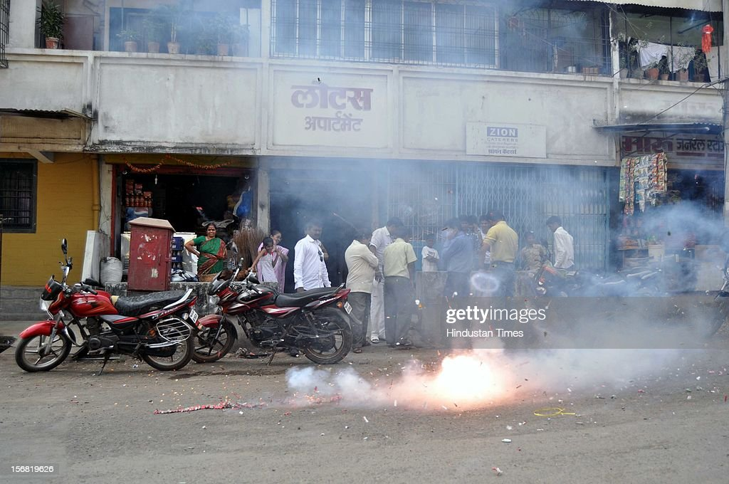 People burn fire crackers to celebrate the news of Ajmal Kasab's hanging on November 21 2012 in Mumbai India Terrorist Ajmal Kasab sentenced to death...