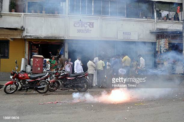 People burn fire crackers to celebrate the news of Ajmal Kasab's hanging on November 21 2012 in Mumbai India Terrorist Ajmal Kasab sentenced to death...