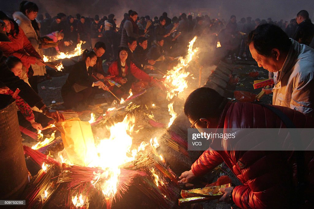 People burn incense sticks to worship Caishen, the God of wealth in China, at Guiyuan Temple on February 12, 2016 in Wuhan, Hubei Province of China. According to the traditional custom, Chinese people worship the God of wealth on the 5th day of lunar new year.