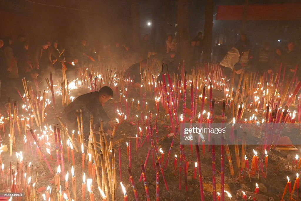 People burn incense to pray for good luck and fortune at a Buddhist temple on first day of new Year of Monkey on February 8, 2016 in Chengdu, Sichuan Province of China. Chinese people celebrate the Spring Festival for the new Year of Monkey, which fell on February 8 according to Chinese calendar.