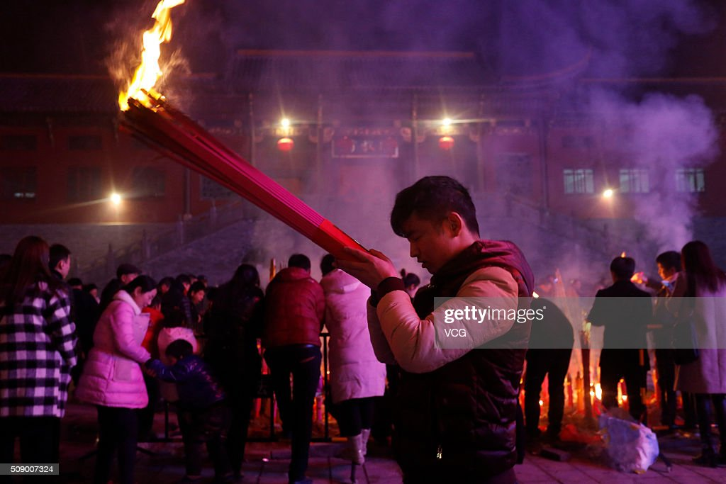 People burn incense to pray for good luck and fortune at a temple on new year's eve on February 7, 2016 in Hefei, Anhui Province of China. Chinese people celebrate the Spring Festival for the new Year of Monkey, which fell on February 8 according to Chinese calendar.