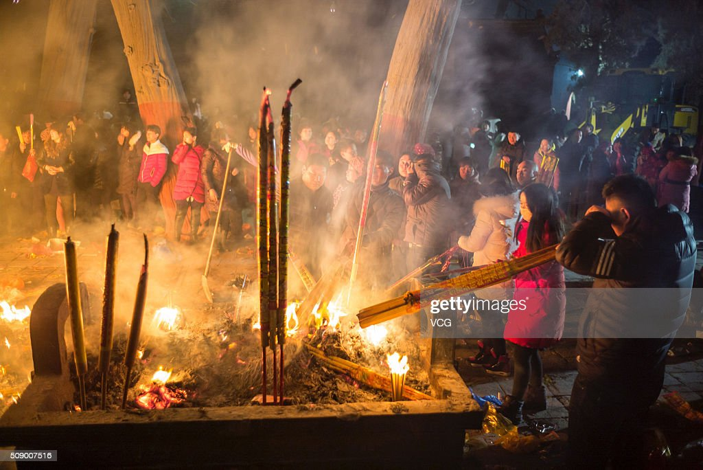 People burn incense to pray for good luck and fortune at a temple on first day of new Year of Monkey on February 8, 2016 in Zhoukou, Henan Province of China. Chinese people celebrate the Spring Festival for the new Year of Monkey, which fell on February 8 according to Chinese calendar.