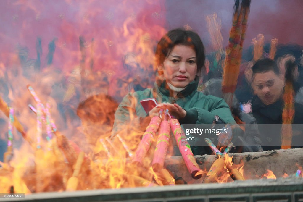 People burn incense to pray for good luck and fortune at the Cien Temple on first day of new Year of Monkey on February 8, 2016 in Shenyang, Liaoning Province of China. Chinese people celebrate the Spring Festival for the new Year of Monkey, which fell on February 8 according to Chinese calendar.