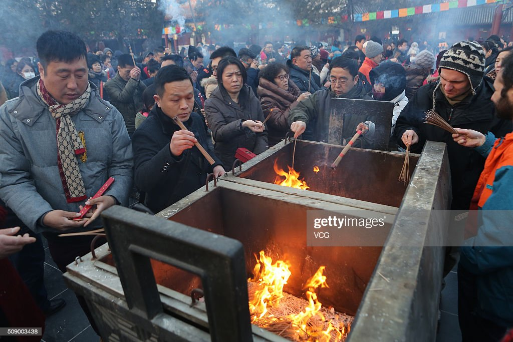 People burn incense to pray for good luck and fortune at the Lama Temple (or Yonghe Temple) on first day of new Year of Monkey on February 8, 2016 in Beijing, China. Chinese people celebrate the Spring Festival for the new Year of Monkey, which fell on February 8 according to Chinese calendar.