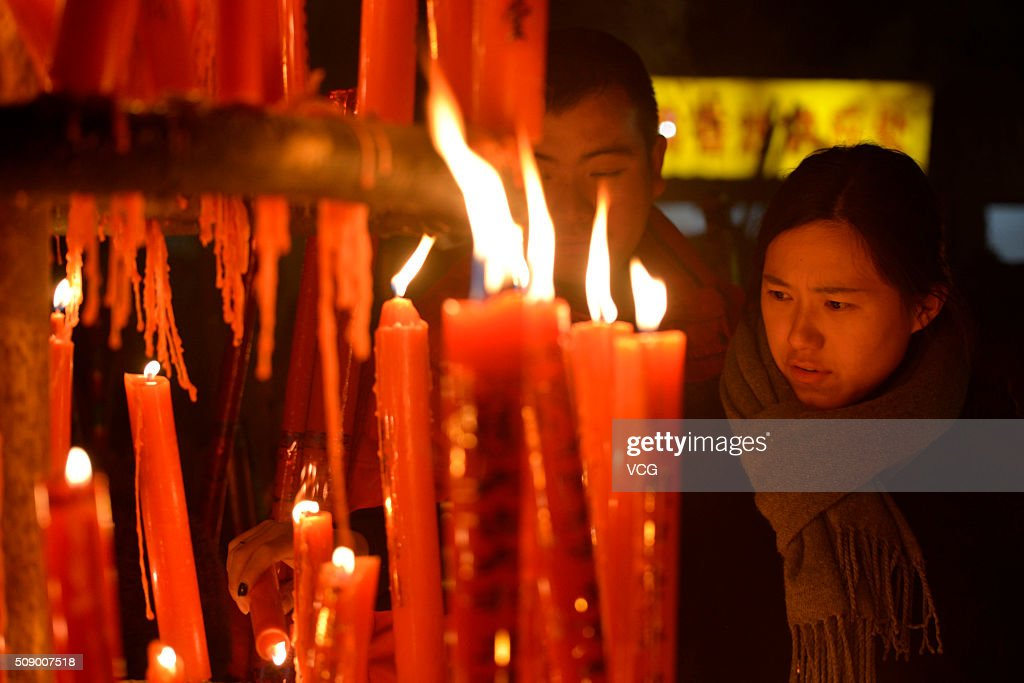 People burn incense to pray for good luck and fortune at the Longxing Temple on first day of new Year of Monkey on February 8, 2016 in Fengyang, Anhui Province of China. Chinese people celebrate the Spring Festival for the new Year of Monkey, which fell on February 8 according to Chinese calendar.