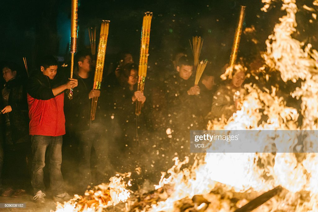 People burn incense to pray for good luck and fortune at the Yuanmiao Taoist Temple on first day of new Year of Monkey on February 8, 2016 in Huizhou, Guangdong Province of China. Chinese people celebrate the Spring Festival for the new Year of Monkey, which fell on February 8 according to Chinese calendar.