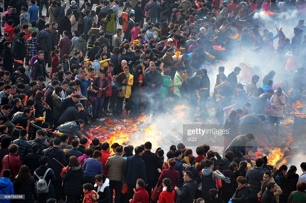 People burn incense to worship Caishen, the God of wealth in China, at Guiyuan Temple on February 12, 2016 in Wuhan, Hubei Province of China. According to the traditional custom, Chinese people worship the God of wealth on the 5th day of lunar new year.
