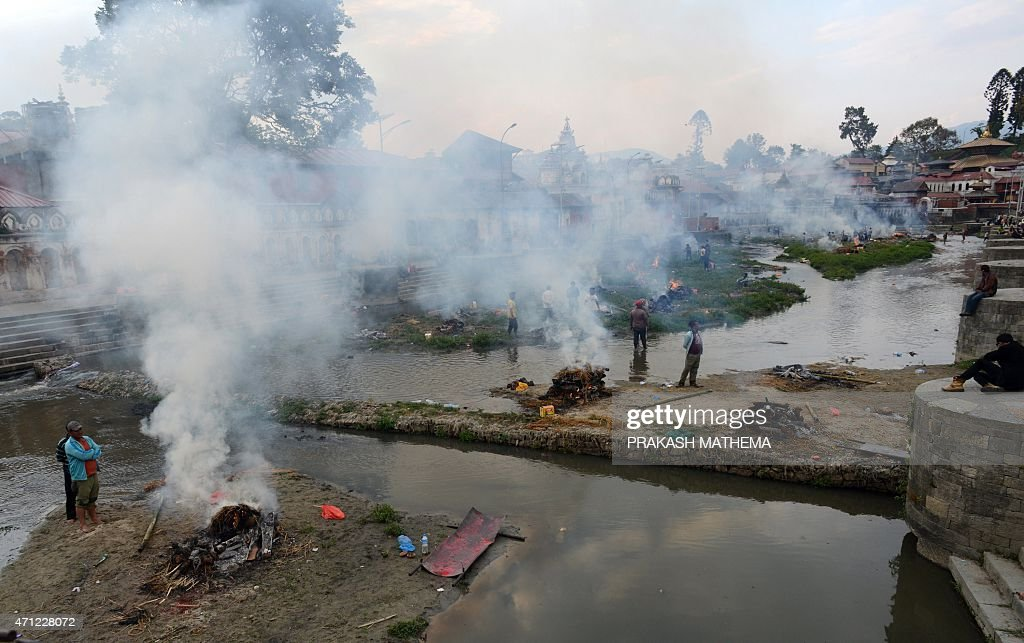 People burn the bodies of earthquake victims at a mass cremation at Pashupatinath in Kathmandu on April 26 2015 Aid groups and governments worldwide...