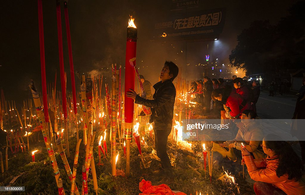People burn the incense greeting for God on February 9, 2013 in Chongqing, China. The Chinese Lunar New Year of Snake also known as the Spring Festival, which is based on the Lunisolar Chinese calendar, is celebrated from the first day of the first month of the lunar year and ends with Lantern Festival on the Fifteenth day.