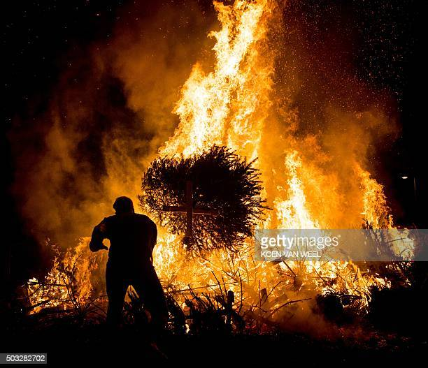 People burn their Christmas trees on the Museum Square on January 3 in Amsterdam The annual tree burning is a New Year's tradition since 1974 / AFP /...