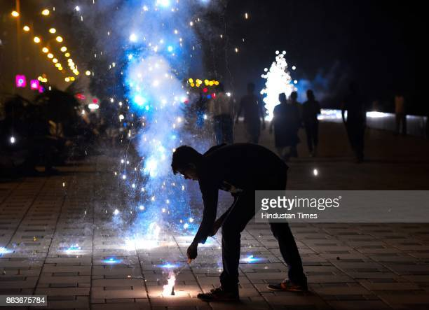 People burst firecrackers at Worli Sea Face on the occasion of Diwali festival known as the 'festival of lights' on October 19 2017 in Mumbai India...
