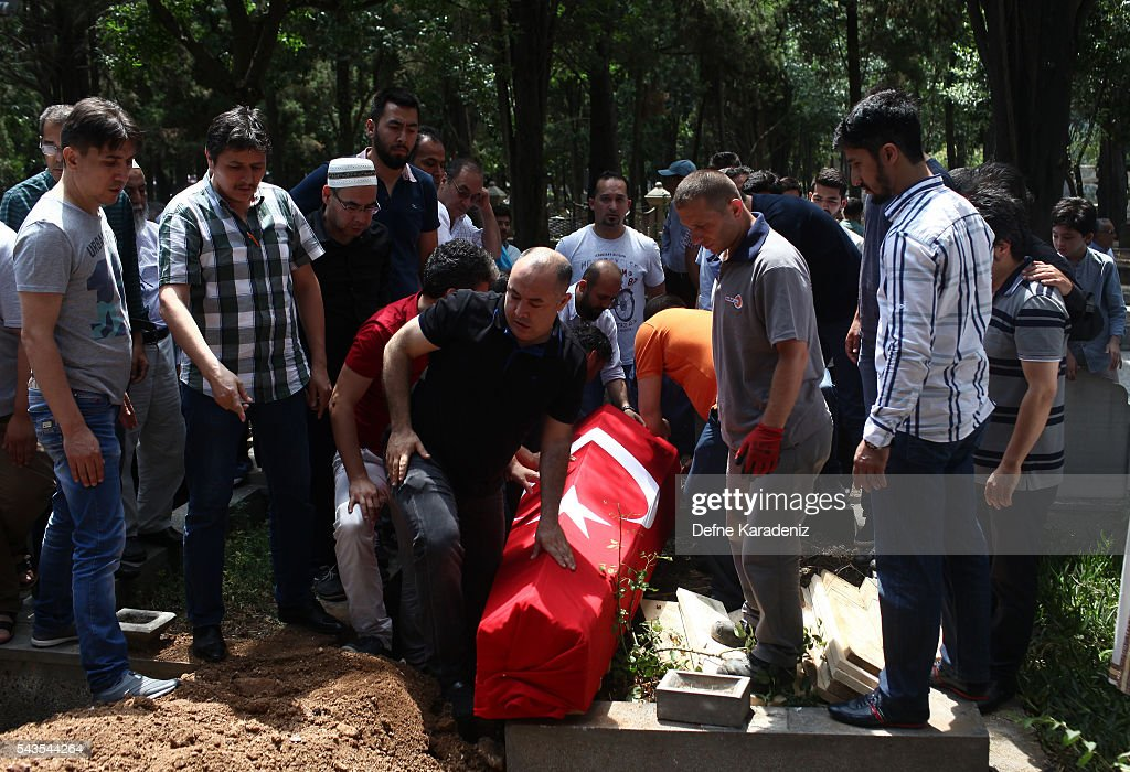 People bury the coffin of airport taxi driver Mustafa Biyikli, who lost his life in the following yesterday's suicide bomb attack in Istanbul Ataturk Airport on June 29, 2016 in Istanbul, Turkey. Three suicide bombers opened fire before blowing themselves up at the entrance to the main international airport in Istanbul yesterday. The Istanbul Governor's Office says 41 people have been killed, 37 of the victims have been identified, including 10 foreign nationals and three people with dual citizenship. More than 230 people were wounded but 109 have been discharged from hospitals in the deadly suicide bombing attack in Istanbul's Ataturk airport blamed on the Islamic State group.