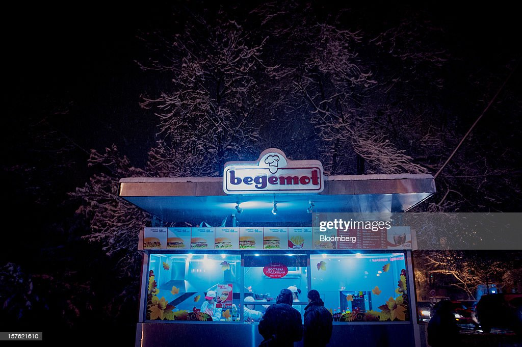 People buy burgers at a fast food kiosk in central Bishkek, Kyrgyzstan, on Monday, Nov. 19, 2012. Landlocked Kyrgyzstan is the only country in the world that hosts both Russian and U.S. military bases. Photographer: Noriko Hayashi/Bloomberg via Getty Images