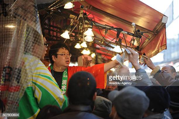People buy fish from a vendor as japanese people prepare to celebrate the New Year at Yameyokocho and Uechu the most famous and the oldest New Year...