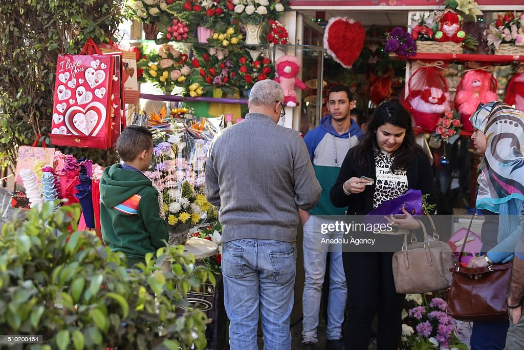 People buy flowers at a flower market during Valentine's Day in Cairo, Egypt on February 14, 2016.