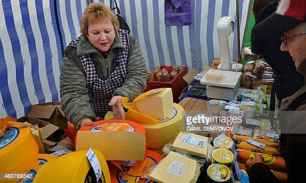 People buy foodstuff at a marketpalce in Russian southern city of Stavropol on December 19 2014 Deep recession skyrocketing prices and a fragile...