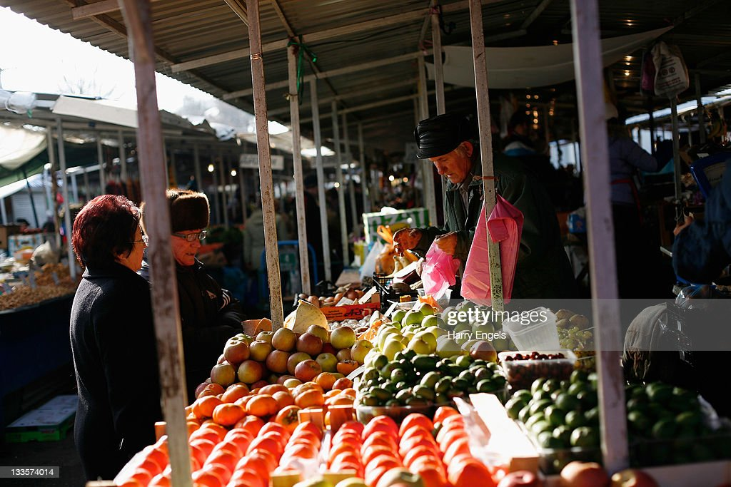 People buy fruit from a seller in the central market on November 19, 2011 in Krasnodar, Russia. Krasnodar is one of thirteen cities proposed as a host city as Russia prepares to host the 2018 FIFA World Cup.