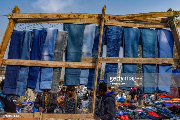 People buy garments from vendors in a market on November 06 2017 in Srinagar the summer capital of Indian administered Kashmir India Markets in the...