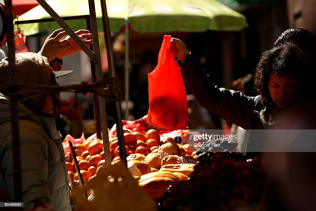 People buy produce at a market on March 17, 2009 in New York City. The Labor Department reported Tuesday a big decline in food prices. Food costs have now fallen for three straight months, declining 1.6 percent in February, the biggest one-month decline in three years.