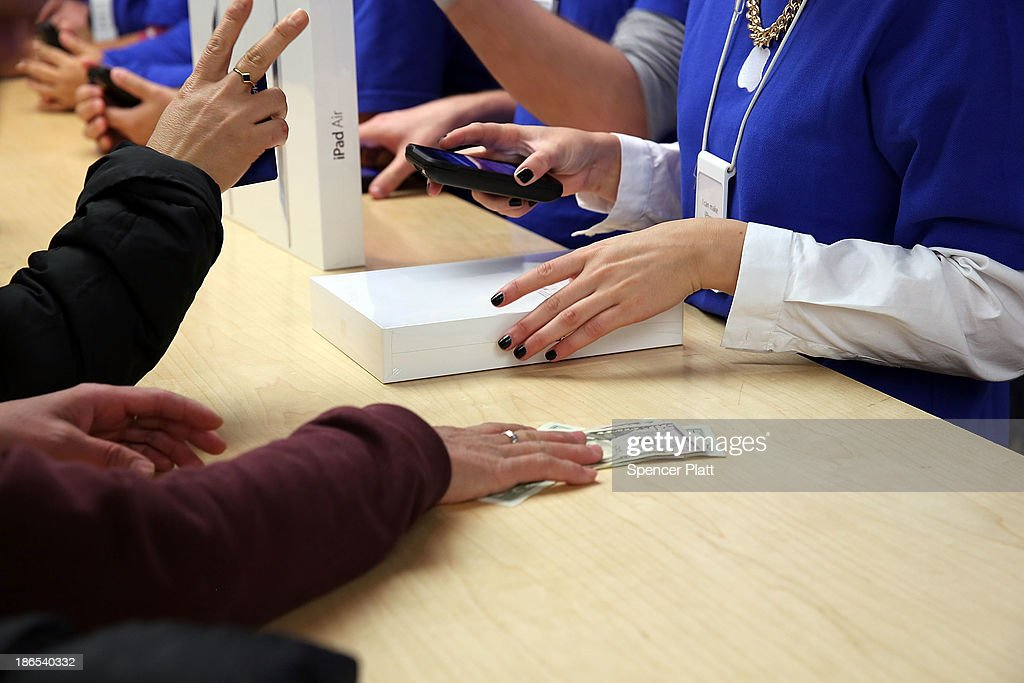 People buy the new Apple iPad Air at the Apple Store on November 1, 2013 in New York City. The new iPad, the fifth generation of the popular tablet, is 20% thinner and 28% lighter than the current fourth-generation iPad. It has the same 9.7-inch screen as previous iPads and uses the same A7 processing chip that's in the iPhone 5S. The iPad Air, which went on sale today, will start at $499 for a 16GB Wi-Fi-only model and go up to $629 for a 16GB with 4G LTE connectivity.