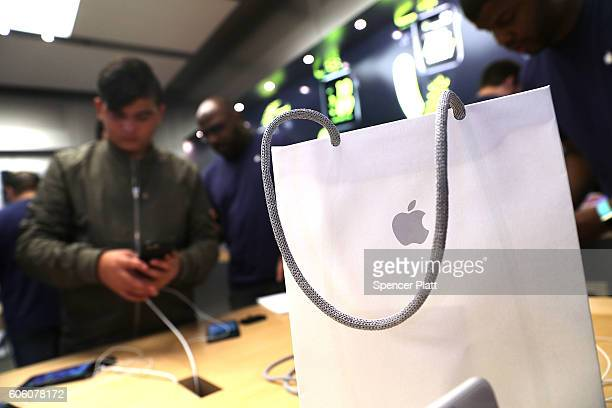 People buy the new iPhone's at an Apple store in Manhattan on September 16 2016 in New York City People around the globe waited in long lines to be...