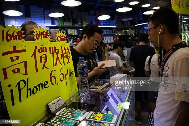 People buying and resell newly purchased iPhone 6 units during the launch of the new Apple iPhone 6 and iPhone 6 plus at Mongkok on September 19 2014...