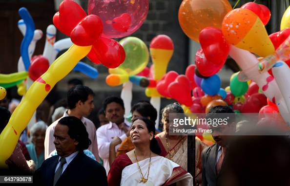People buying balloons during Christmas celebrations after attending the mass Outside the Sacred Heart Church khar on Saturday Morning