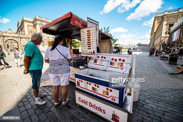 People buying  drinks and snacks in Stockholm, Sweden