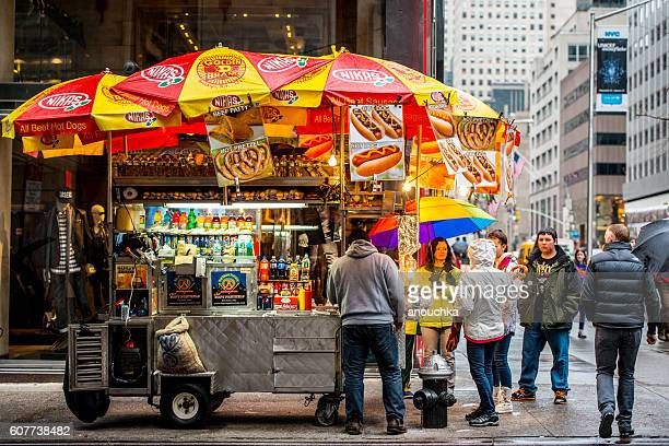 People buying fast food on New York street, USA