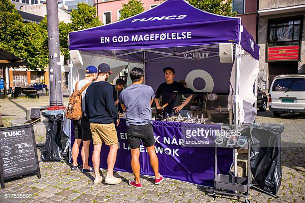 People buying fast food on Oslo street, Norway