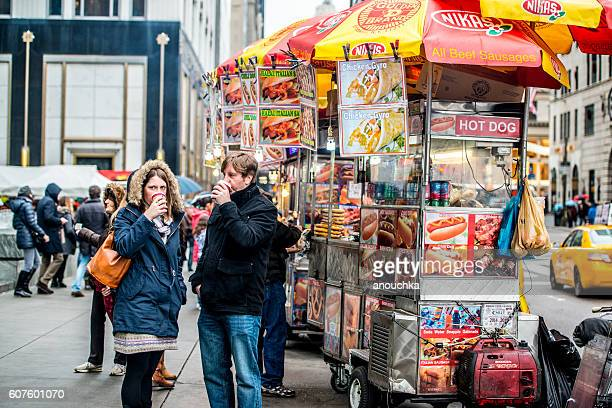 People buying food and drinks on 5th Avenue, NYC