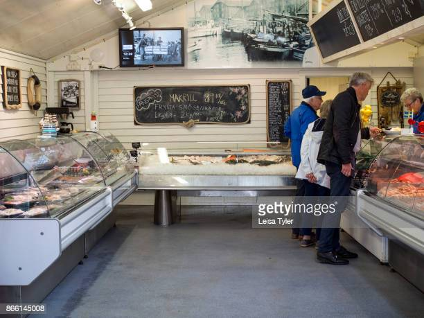 People buying fresh fish from the fish market in Smögen a small town on Sweden's West Coast