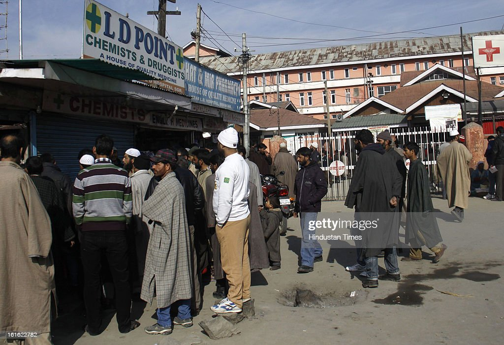 People buying medicines at a medical shop near Lal Ded Hospital after curfew was lifted from some parts of valley after five days on February 13, 2013 in Srinagar, India. Curfew was was imposed by the authorities last Saturday to control Law and order situation after the execution of Parliament attack convict Afzal Guru.