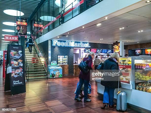 People buying snacks  at Copenhagen Airport, Denmark