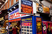 People buying  theatre tickets in Leicester Square.