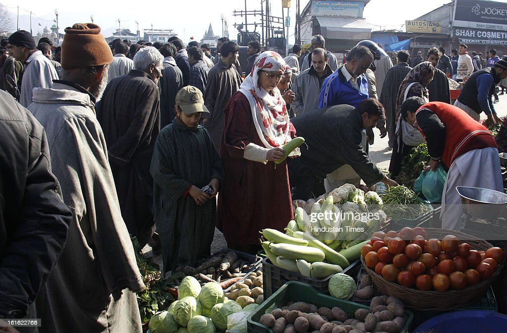 People buying vegetables at Hari Singh High Street after curfew was lifted from some parts of valley after five days on February 13, 2013 in Srinagar, India. Curfew was was imposed by the authorities last Saturday to control Law and order situation after the execution of Parliament attack convict Afzal Guru.