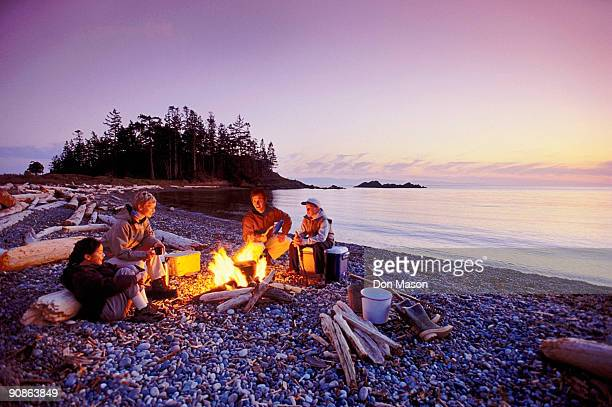 People by a campfire