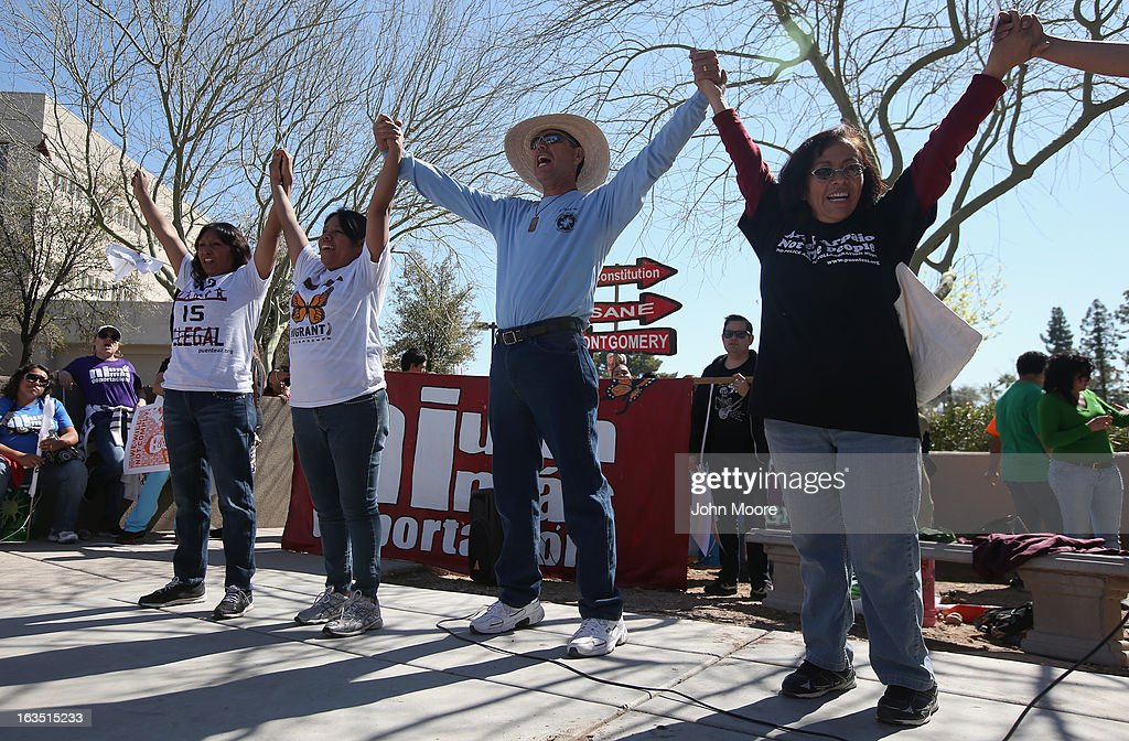People call for immigration reform outside the U.S. Immigration and Customs Enforcement (ICE), office on March 11, 2013 in Phoenix, Arizona. The march called for an end to ICE deportation, family separation and workplace raids on immigrants.