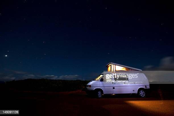 People camping in a van.