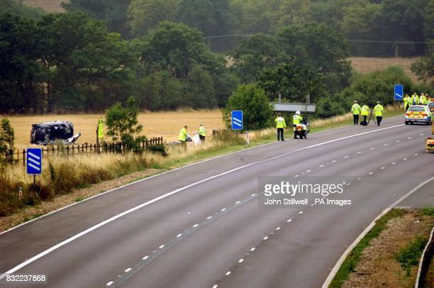 A people carrier lying on its side in a field close to junction 29 of the M25 motorway after the car crashed earlier this morning Three people were...