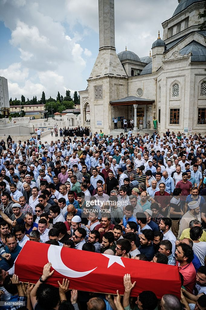 People carry a coffin covered with Turkish national flag of Hamidullah Safar on June 30, 2016 during his funeral two days after he was killed by a suicide bombing and gun attack targeted Istanbul's Ataturk airport, killing 42 people The death toll from the triple suicide bombing and gun attack that occurred on June 28, 2016 at Istanbul's Ataturk airport has risen to 43 including 19 foreigners. The government has pointed the finger of blame at the Islamic State group and Turkish police rounded up 13 suspected IS jihadists in raids at 16 different locations across Istanbul on June 30. KOSE
