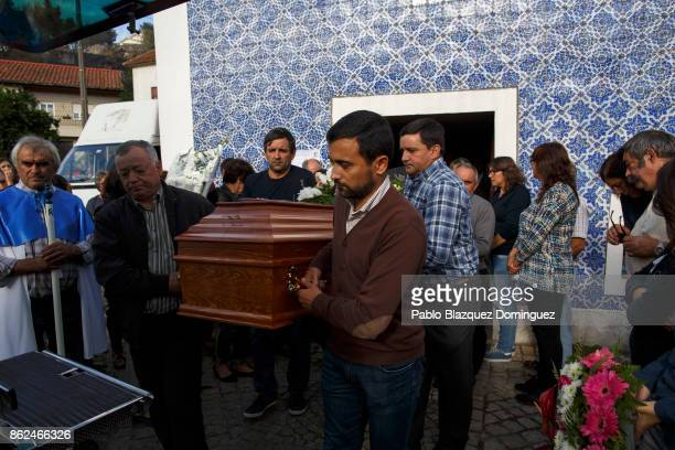 People carry a coffin during the funeral of a victim of a wildfire in the village of Vila Nova near Vouzela on October 17 2017 in Viseu region...