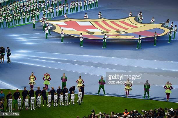 People carry a giant logo of FC Barcelona during the opening ceremony of the UEFA Champions League Final football match between Juventus and FC...