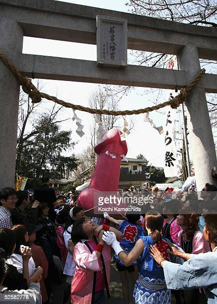 People carry a large pink phallus as part of the annual Utamaro Festival April 3 2005 in Kawasaki Japan The Utamaro Festival is traditionally held...