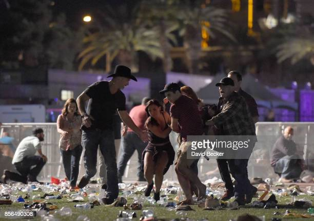 People carry a peson at the Route 91 Harvest country music festival after apparent gun fire was heard on October 1 2017 in Las Vegas Nevada There are...