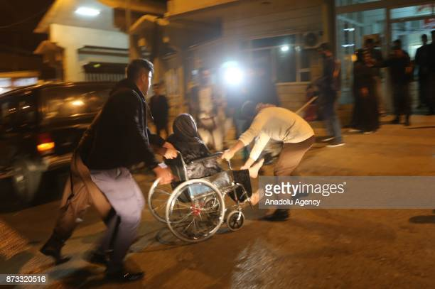 People carry a wounded person for treatment at Sulaymaniyah Hospital after a 72 magnitude earthquake hit northern Iraq in Sulaymaniyah Iraq on...