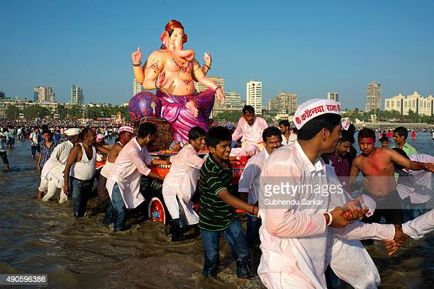 People carry an idol of lord Ganesha for immersion into the Arabian sea in Mumbai Ganesha Chaturthi or Ganapati festival is celebrated in honour of...