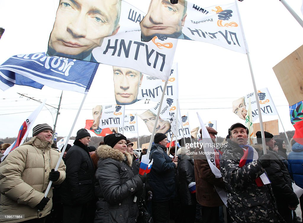 People carry banners in support of Vladimir Putin during a procession ahead of a mass rally on February 23, 2012 in Moscow, Russia. Thousands attended the mass rally during which Vladimir Putin delivered a speech in support of his bid for re-election in the upcoming presidential election on March 4.